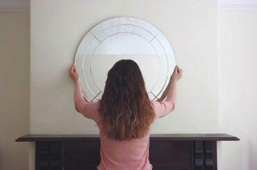women-hanging-mirror